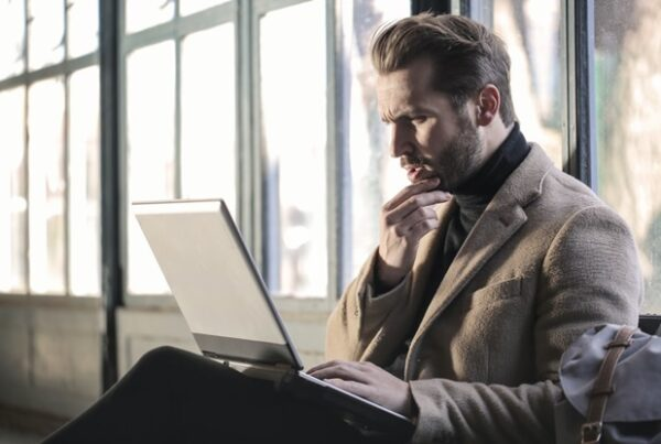 Man watching an online ad on his laptop.