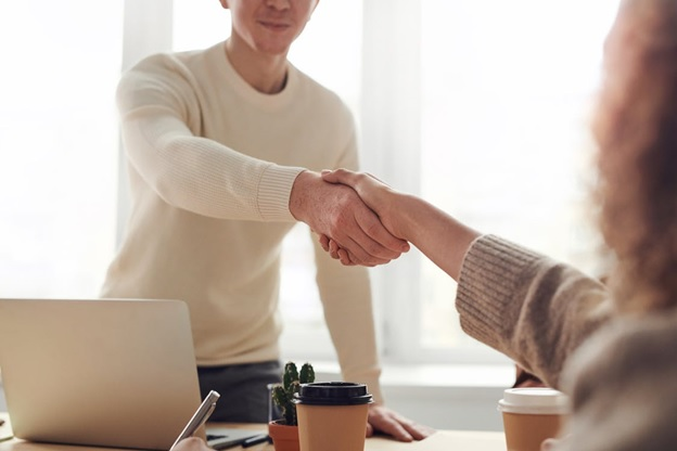 People shaking hands after a business meeting.