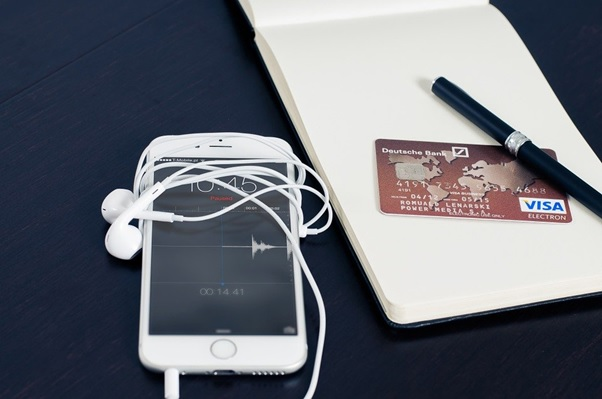A user's mobile device and a credit card used for online shopping