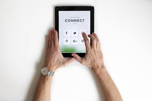 Man using social media on tablet
