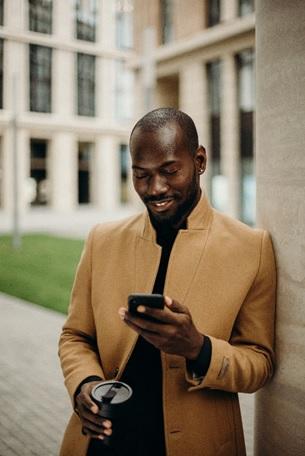 a man providing social media marketing services in Ottawa on the go